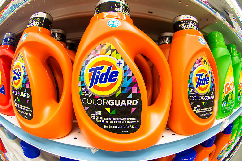 Tide laundry detergent in store shelf.Tide is the brand-name