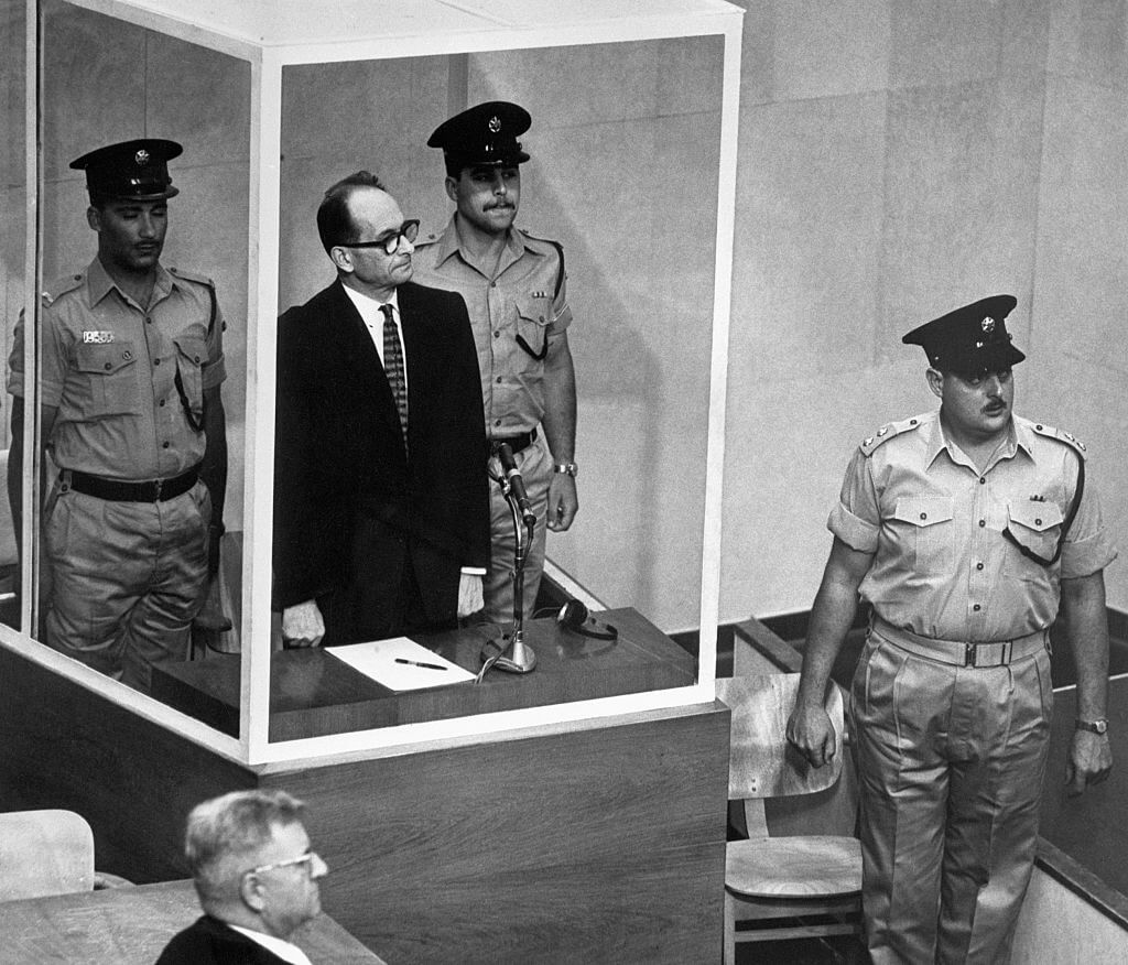 Adolf Eichmann Stands with Israeli Police During Trial