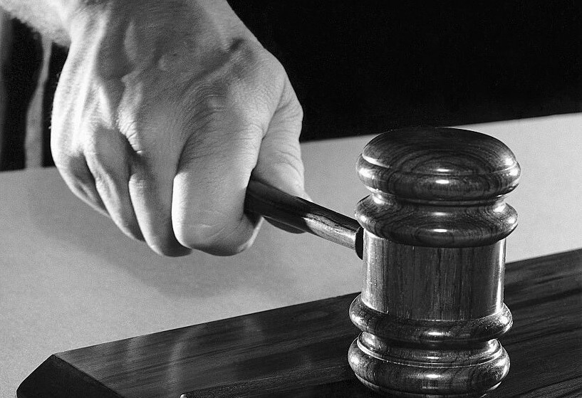 Judge's Hand Hammering Gavel