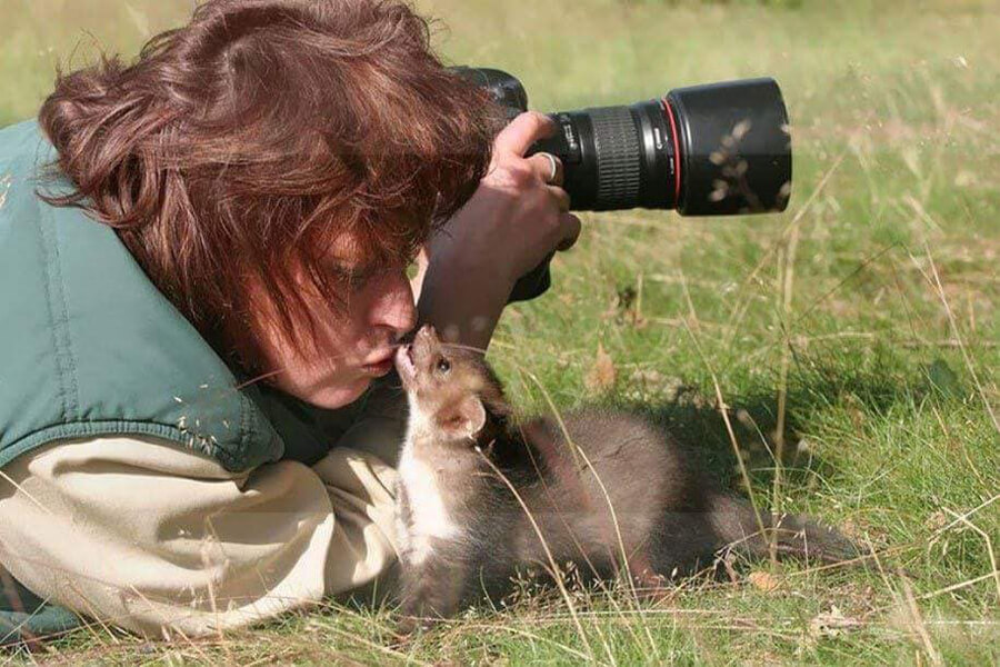 animal biting photographer in nose
