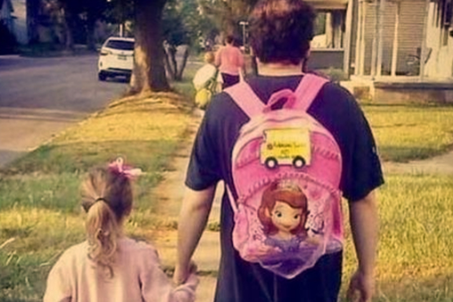 dad weaing daughter's backpack