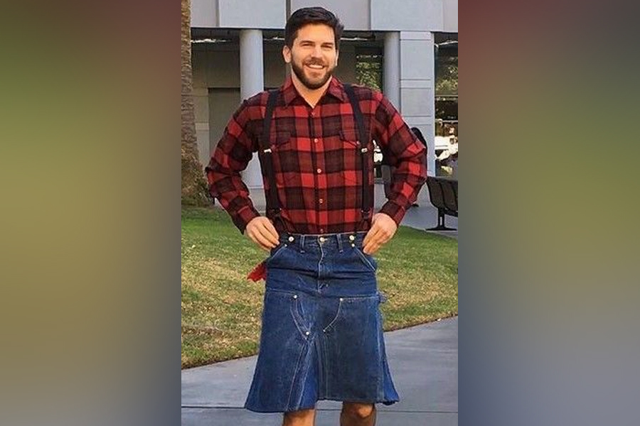 man in denim kilt