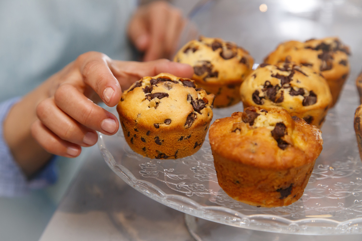Woman taking a muffin