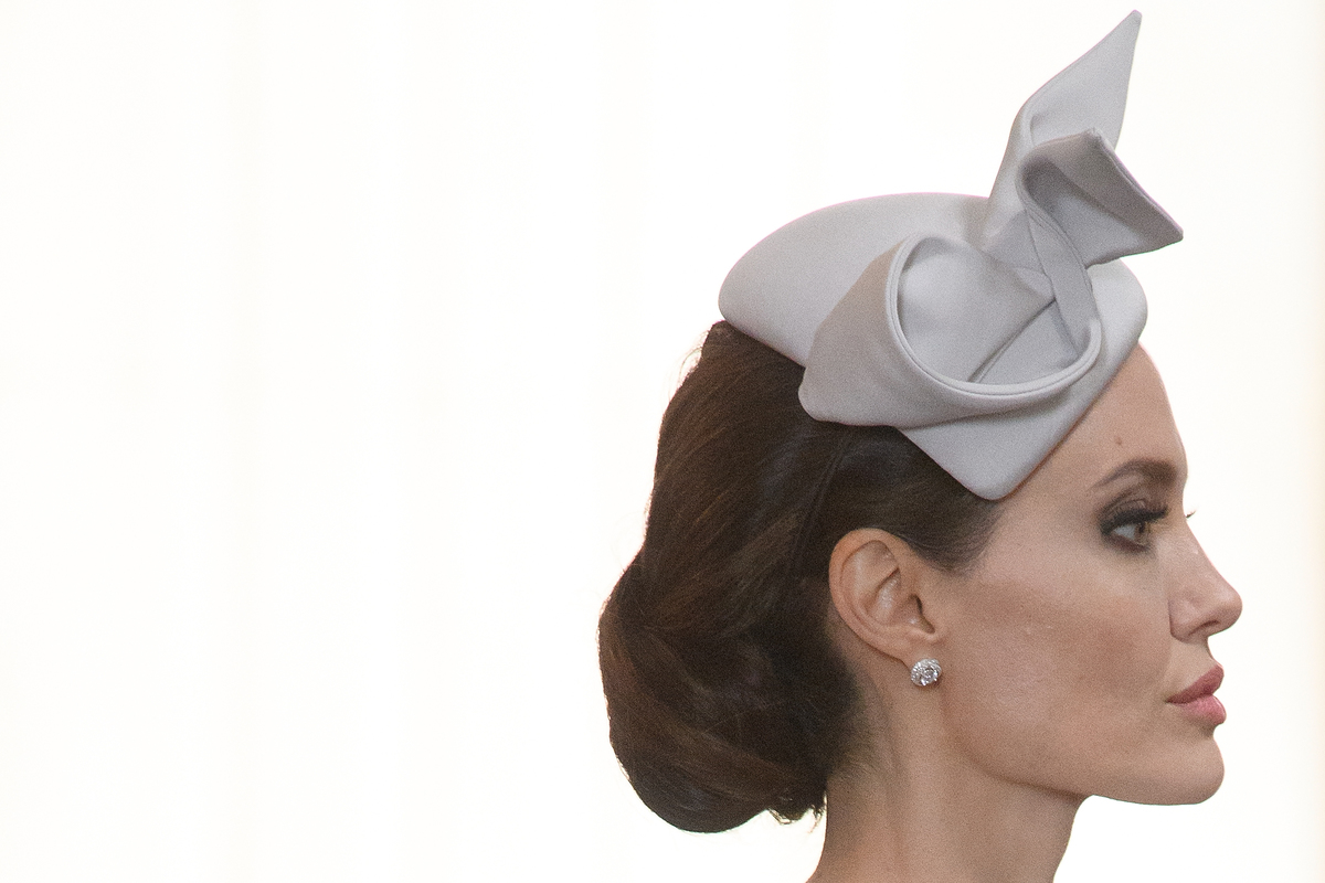Angelina wears a gray hat