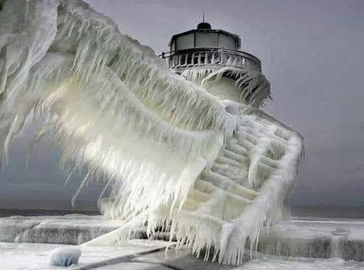 a-frozen-lighthouse-near-lake-