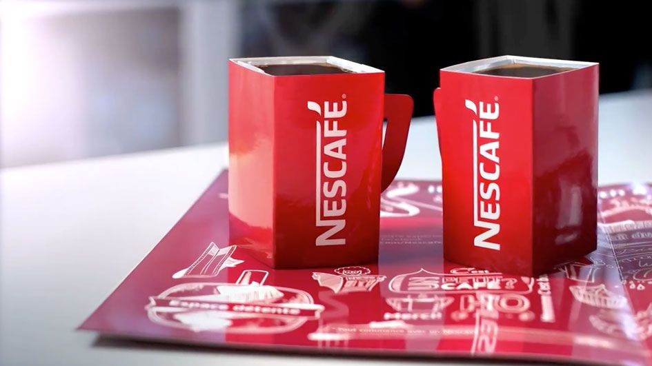 nescafe pop up cafe trolls starbucks