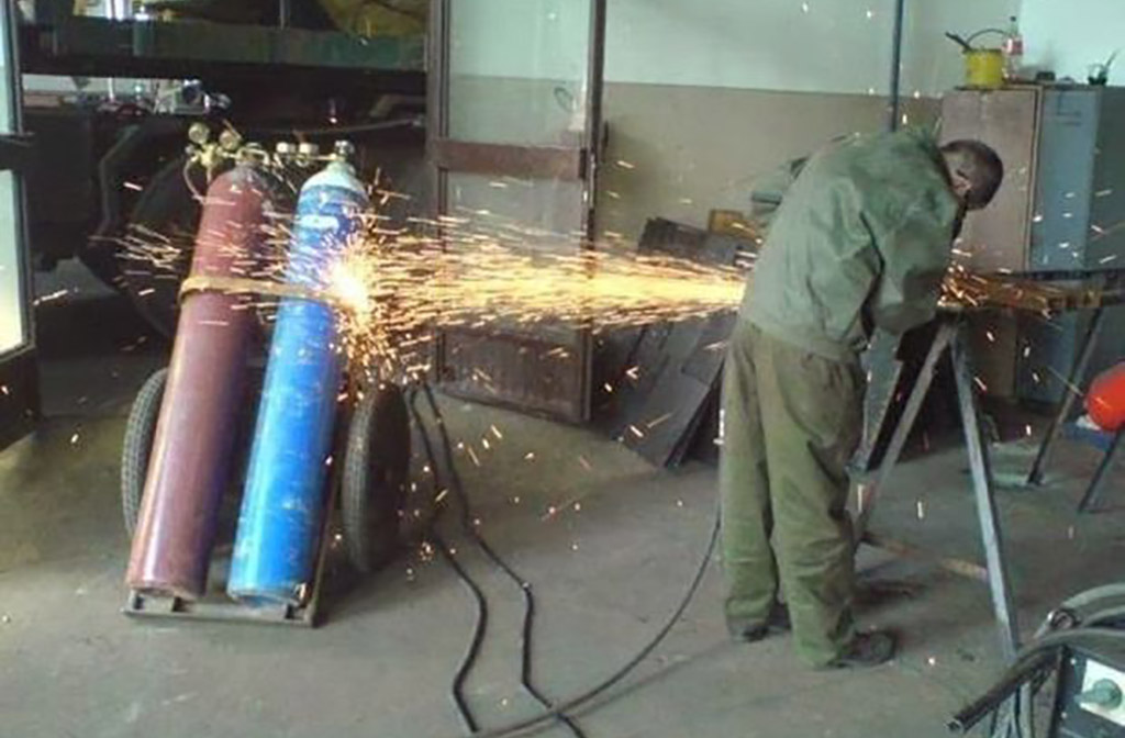 blowtorch hitting cans of gas