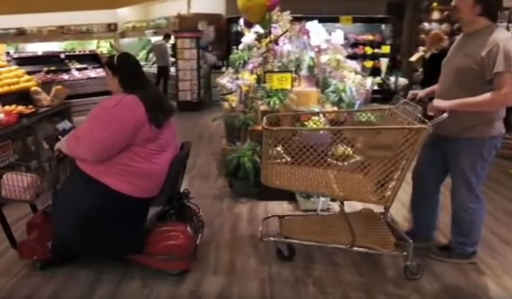 Amber on motorized scooter in grocery store