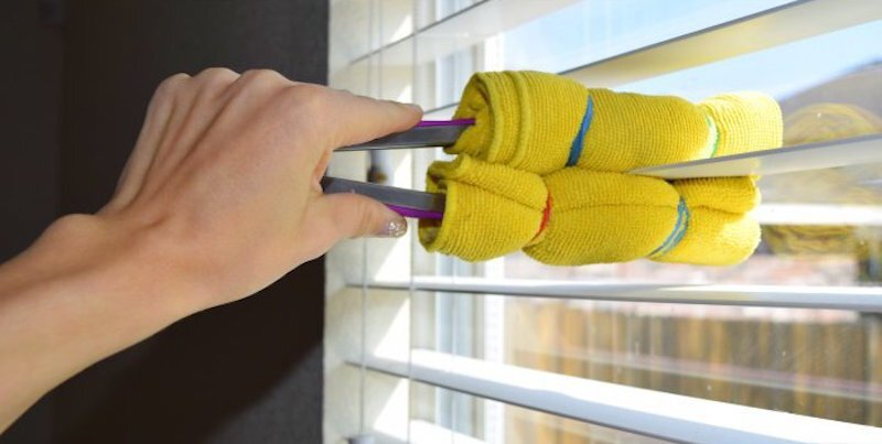 use tongs with cloth to clean blinds