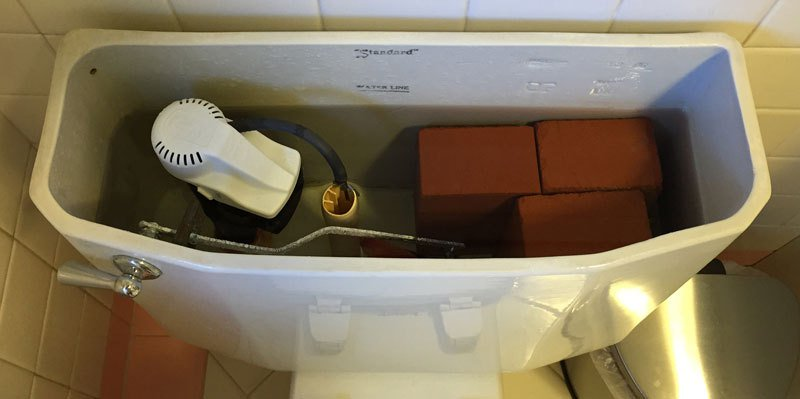 put a brick in toilet to reduce water usage