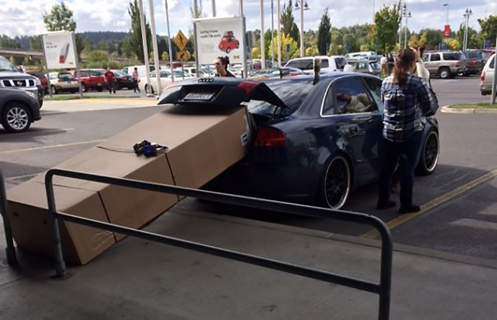 trying to fit huge box into small car