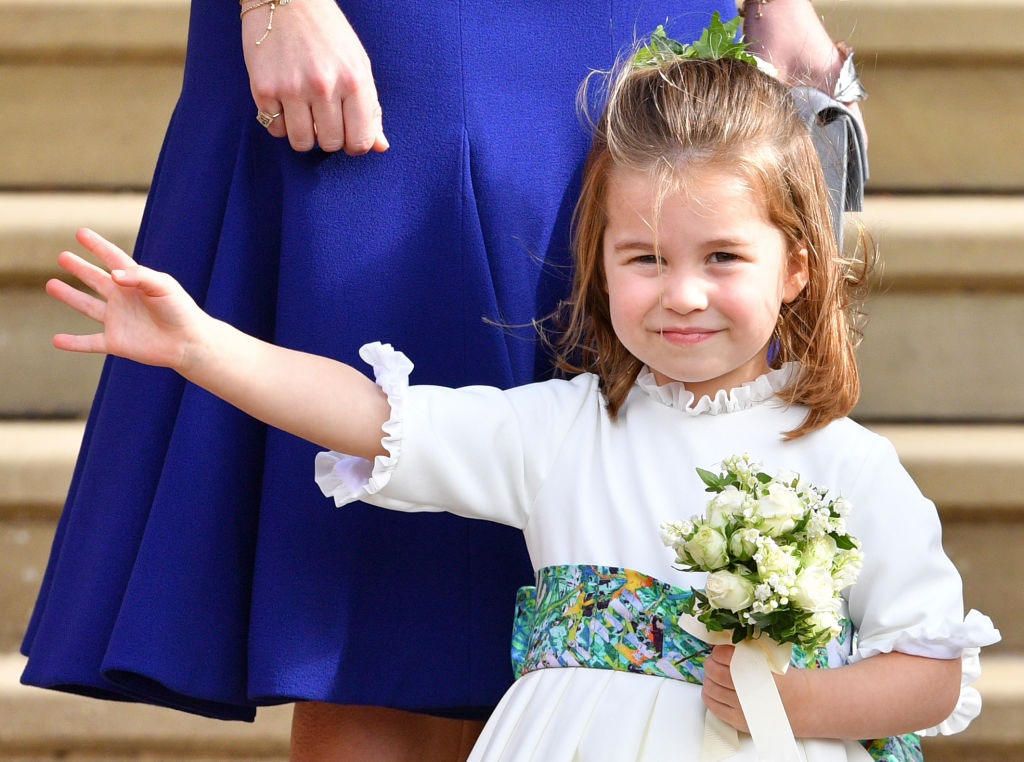 Princess Charlotte of Cambridge attends the wedding of Princess Eugenie of York and Jack Brooksbank at St George's Chapel