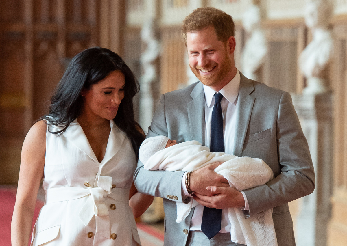 Prince Harry, Duke of Sussex (R), and his wife Meghan, Duchess of Sussex, pose for a photo with their newborn baby son, Archie Harrison Mountbatten-Windsor