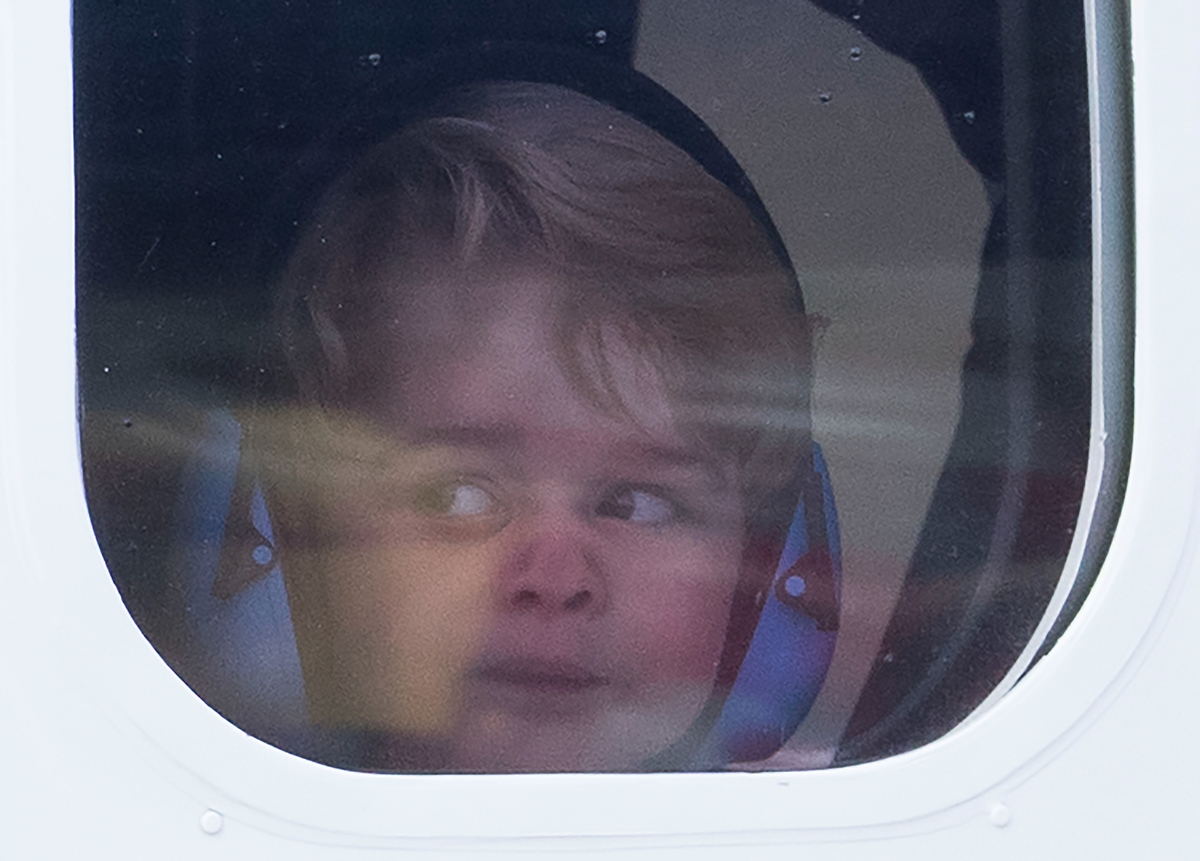 Prince George of Cambridge looks out of the window of a sea plane
