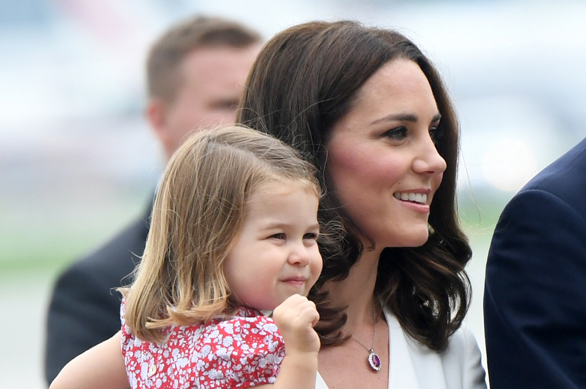 Catherine, Duchess of Cambridge carries Princess Charlotte of Cambridge