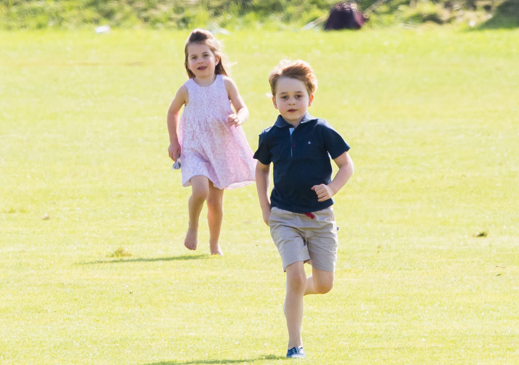 rince George of Cambridge and Princess Charlotte of Cambridge run together