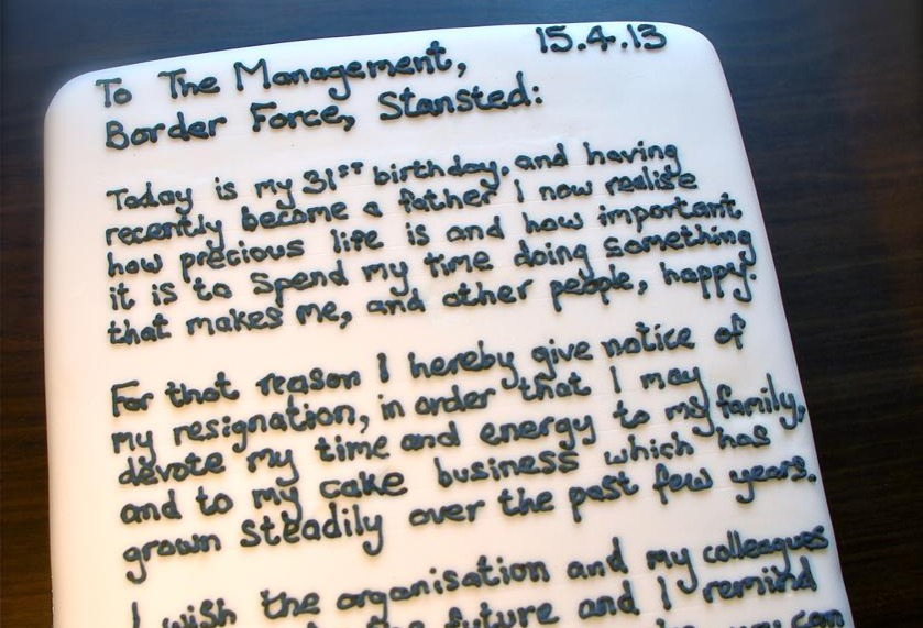 a resignation letter written on a cake