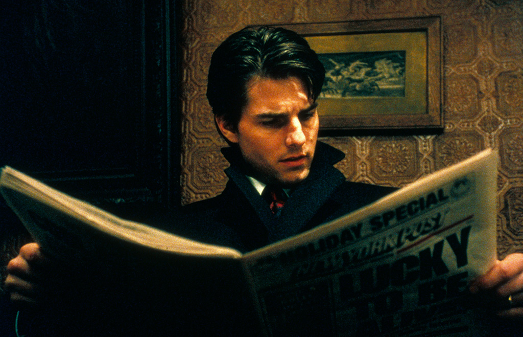 Tom Cruise Character reading a paper