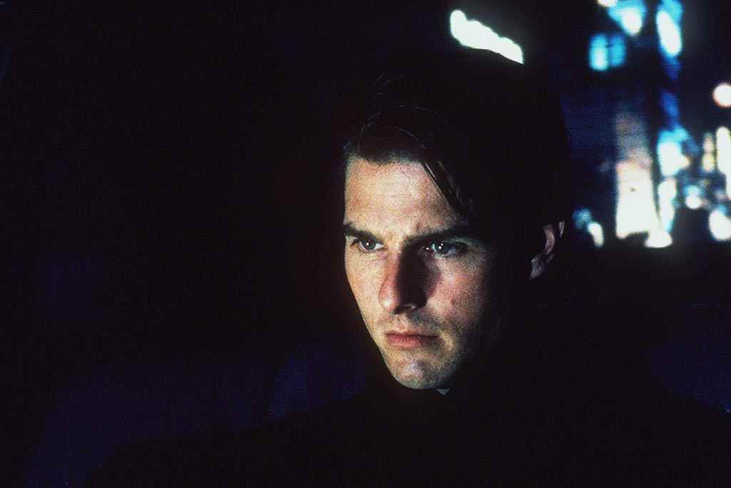 Tom Cruise in a dark scene