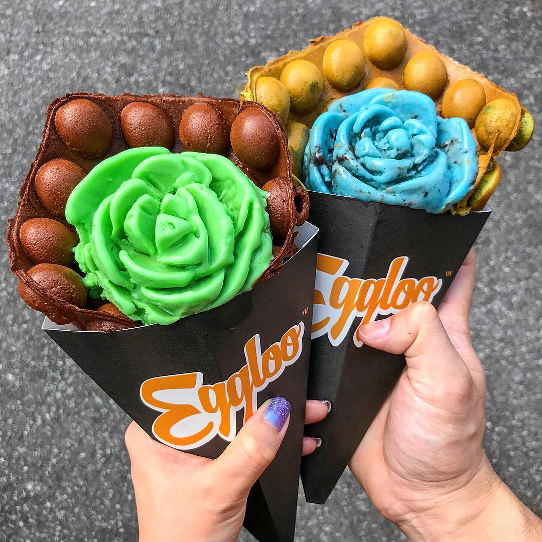 rose shaped icecream in bubble waffle cones