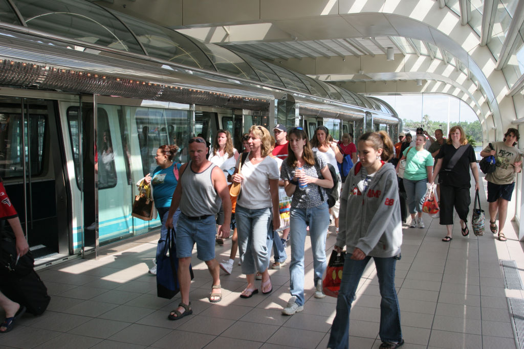 Passengers leaving the train to go into Orlando Airport.