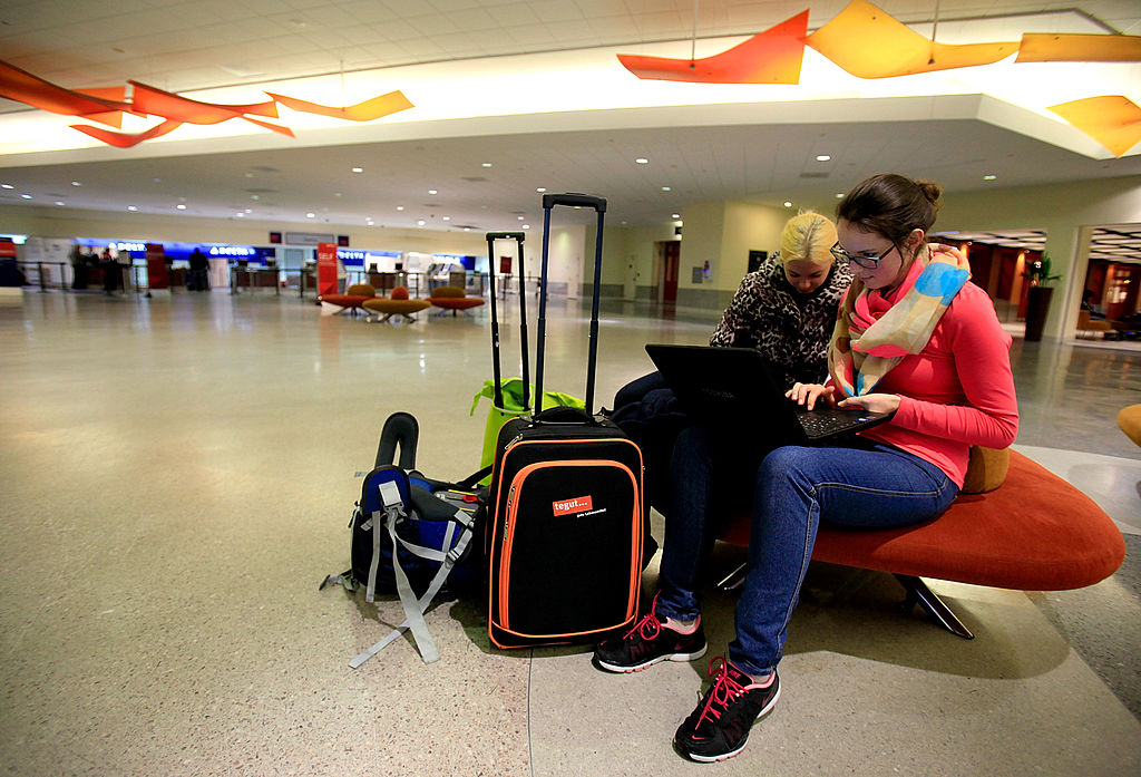 Stranded tavelers sit as air transportation has been canceled