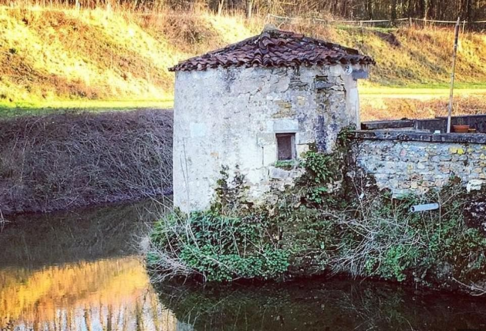 600 year old turret sitting on the moat of the Chateau de Bourneau