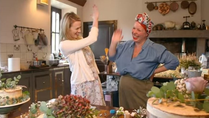 Erin and Angel high-fiving in Angel's chateau