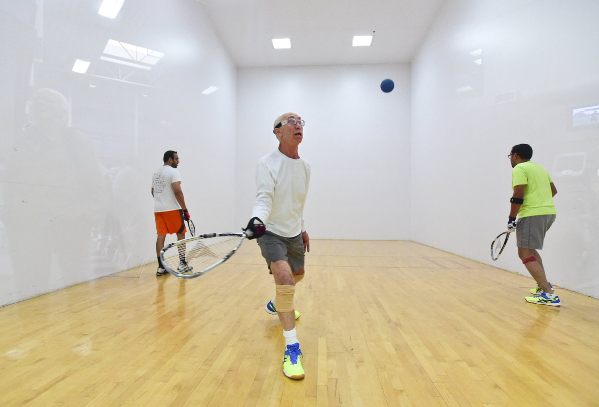 Sandeep Reddy, of Longmont, Chris Hawley, of Longmont, and Vishwanath Mantha, of Erie, play on the racquetball court at the Ed and Ruth Lehman YMCA of Longmont.