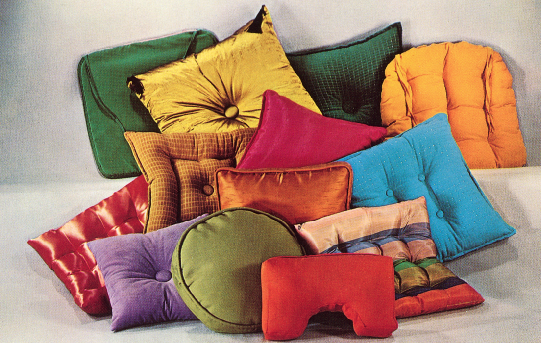 assortment of multi-colored throw pillows.