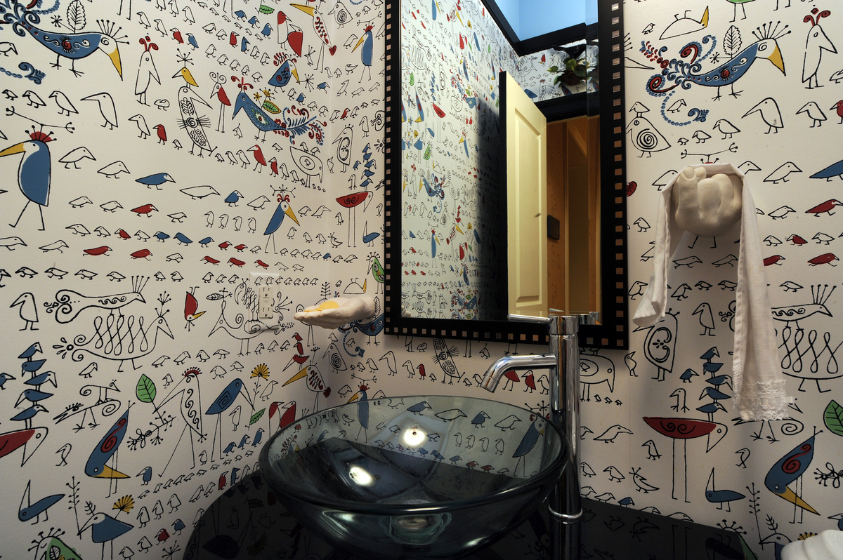 This wallpaper pattern is called Aviary by Schumacher and is used in a hall bath