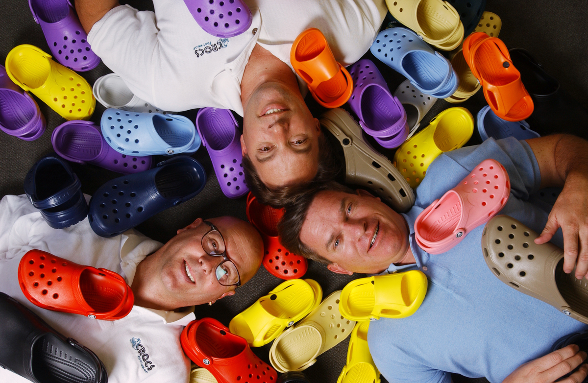 The founders of Crocs footwear pose with a variety of their products at their Niwot offices.