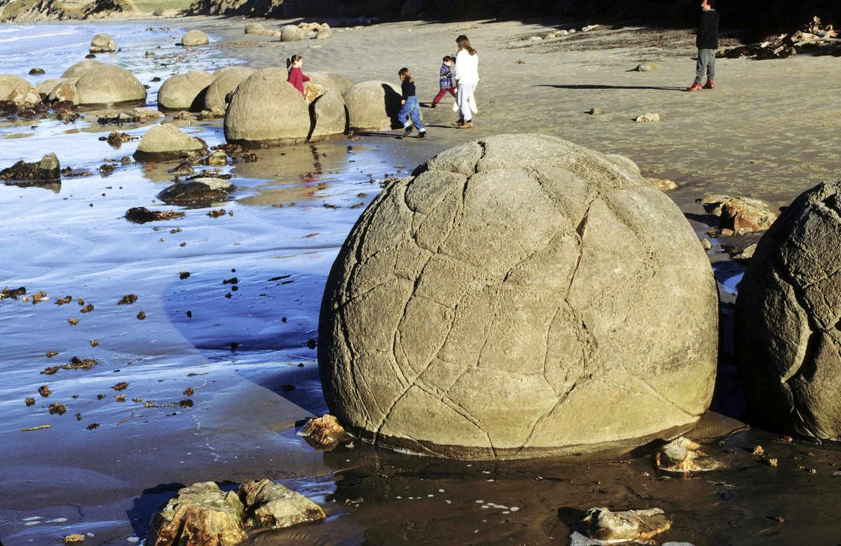 Moeraki boulders started 60 million years ago, mudstone cliffs then eroded by waves and boulders fell to beach, North Otago, New Zealand.