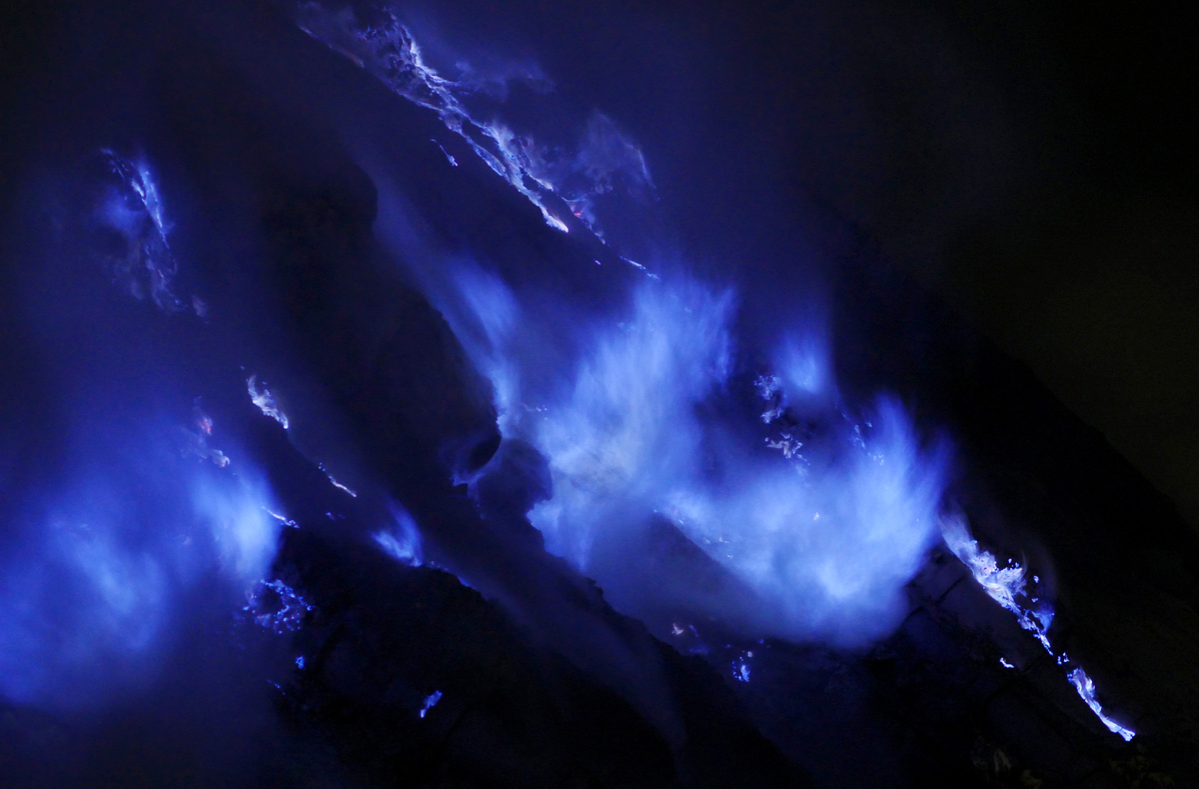 A FLAMING hot volcano glows in the dark as its sulphuric gases burn sapphire blue at the Kawah Ijen volcano in east Java, Indonesia