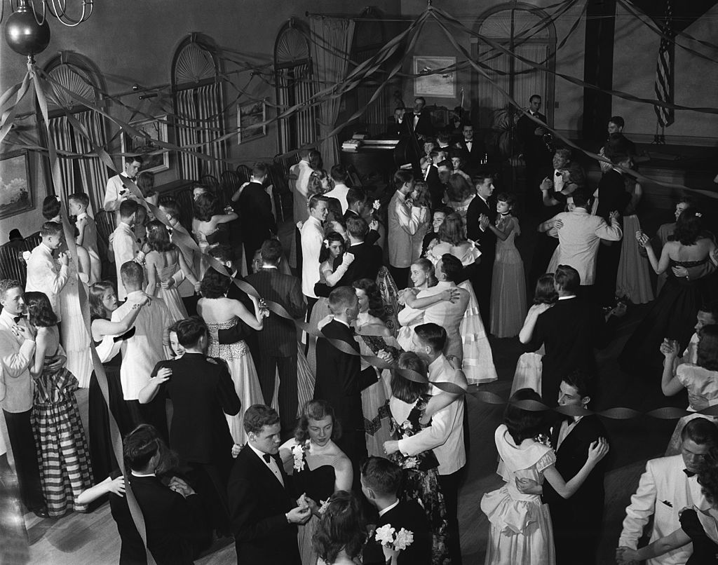 old school dance or prom with streamers hanging from ceiling