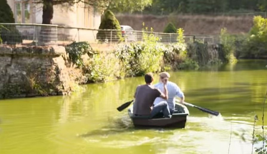 JB and Erin rowing along the Chateau de Bourneau moat