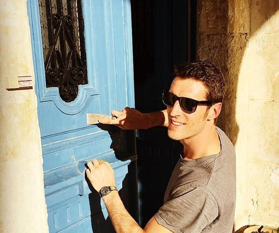 JB restoring a blue door in the Chateau de Bourneau
