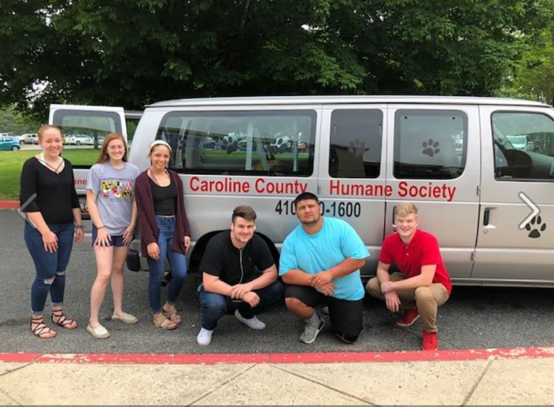Members of the Caroline County Humane Society standing outside of the company vana to Ikea