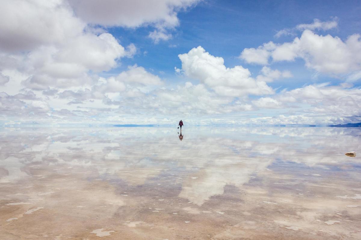 Walking the largest mirror in the world, Salar de Uyuni