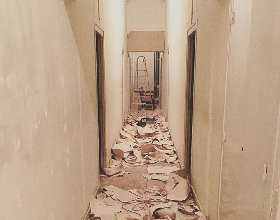 Picture of south corridor of Chateau with crumbling brown wallpaper