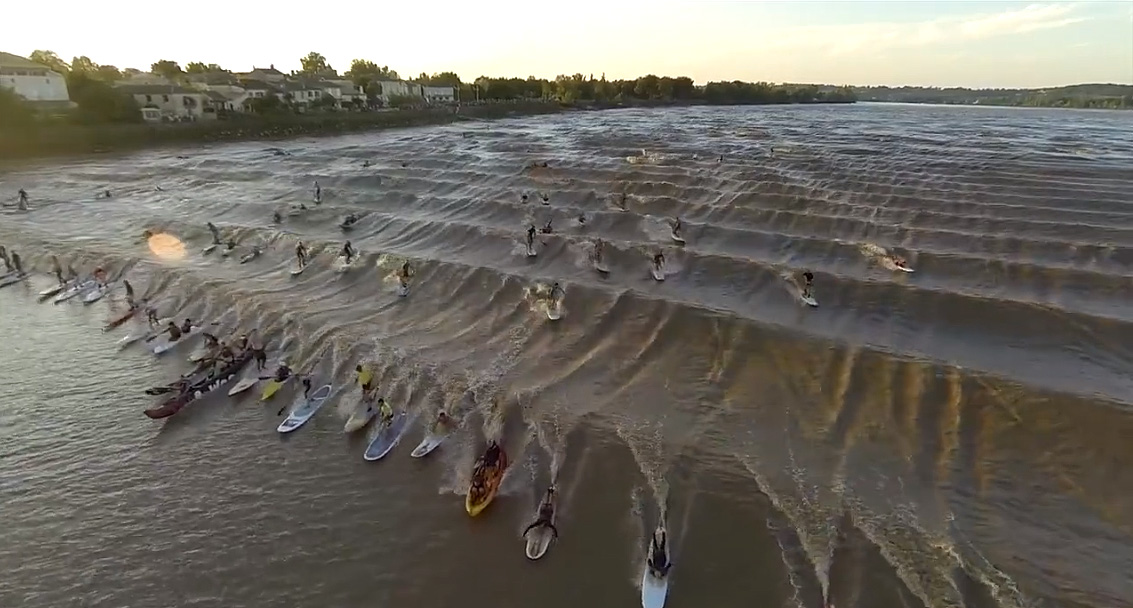 surfers ride the never ending wave of Pororoca in a national championship