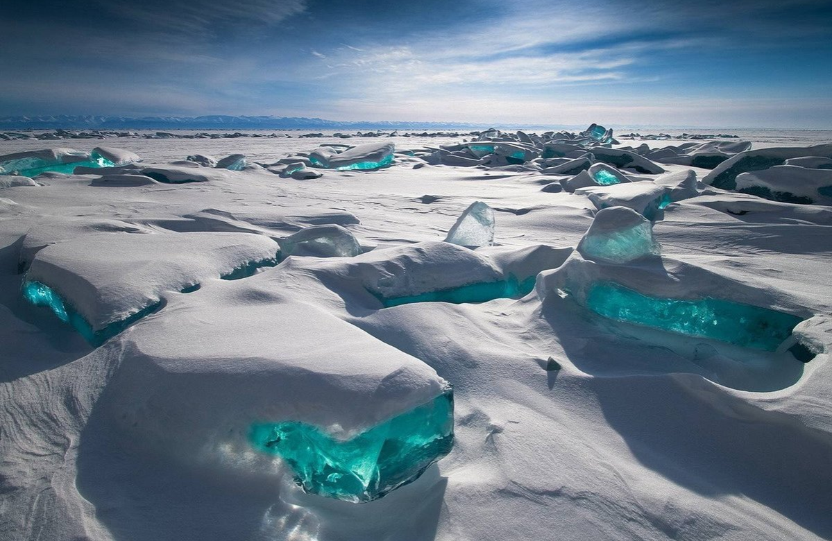 turquoise ice on Lake Baikal in Siberia, Russia
