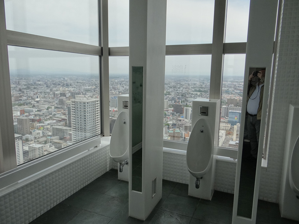 toilets facing sapporo city, in the JR Tower