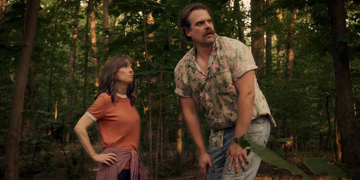 Hopper wearing Hawaiian shirt like magnum pi