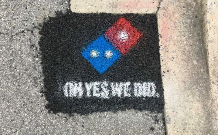 Domino's stamped Oh yes we did onto pothole fillings they did for Pave for Pizza
