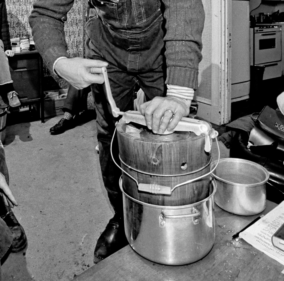 Tufts Roots and Growth House program director professor Jesper Rosenmeier uses an old-fashioned hand crank freezer to make 'academic ice cream,' Medford, Massachusetts, 1973.