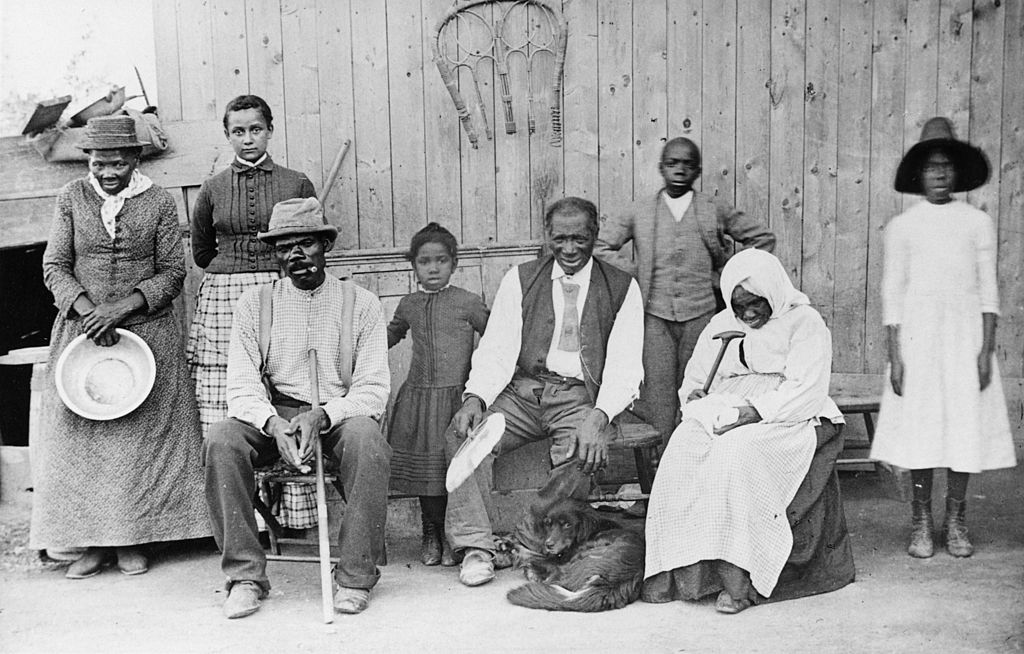 GettyImages-3112133 circa 1900: On the far left, abolitionist leader, Harriet Tubman (c1820 - 1913) ex- slave and founder of the 'Underground Railroad' which provided safe houses for escaping slaves.