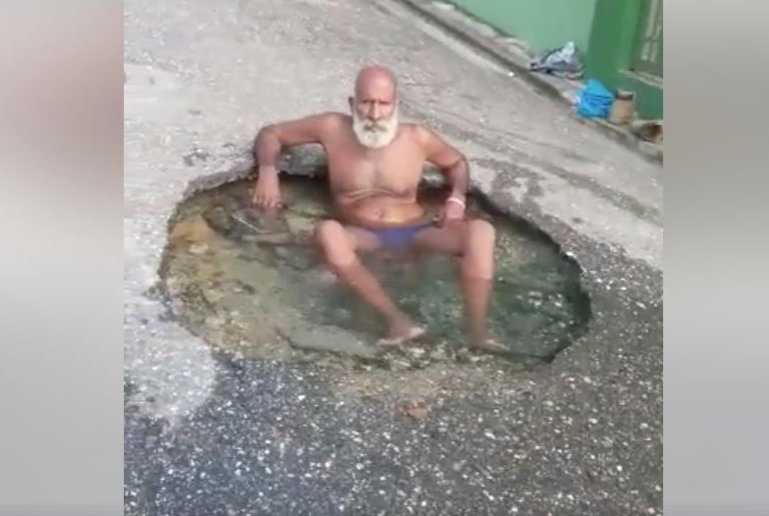 Ken in his jacuzzi, a pothole in Trinidad and Tobago