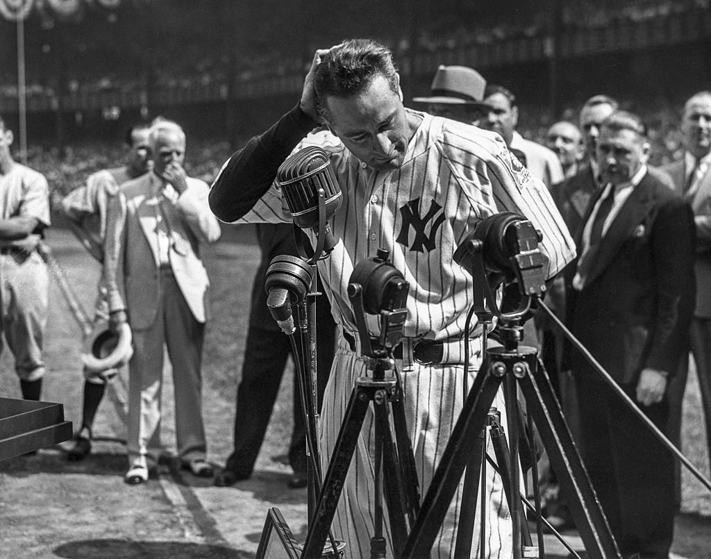 Lou Gehrig #4 of the New York Yankees is shown before the mic delivering his farewell speech on Lou Gehrig Day on July 4, 1939 at Yankee Stadium in the Bronx, New York.