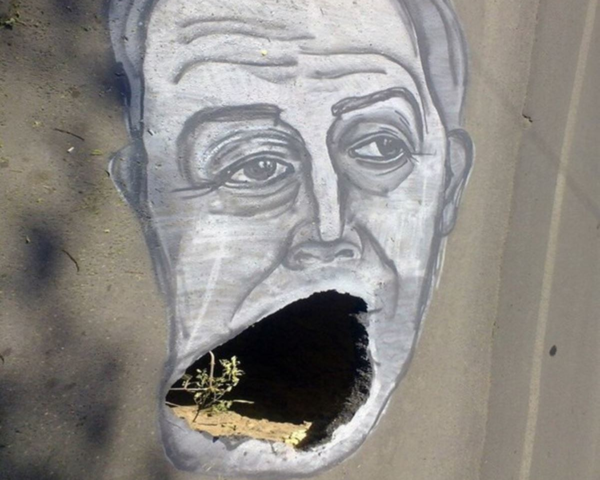 depiction of Russian governor Valery Radayev drawn around a pothole